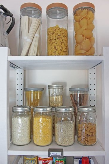 Use a variety of storage jars to give your open shelving pantry character and interest.