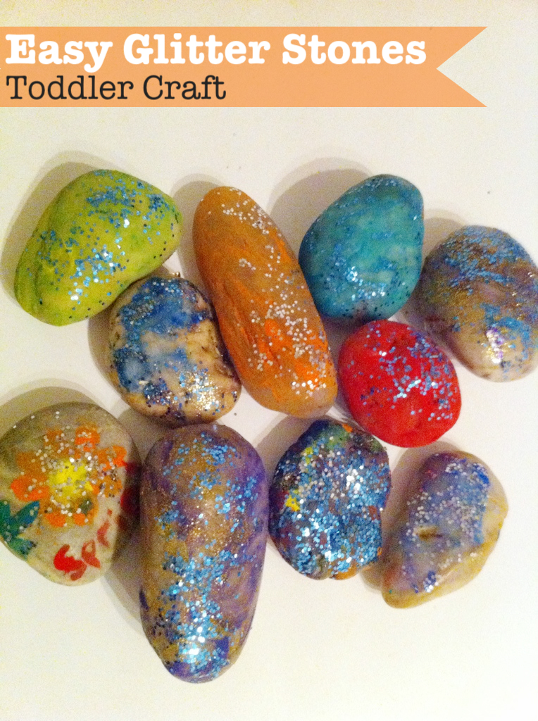 Painting rocks to make easy glitter stones. This toddler craft is so easy and could be adapted for Fathers day!