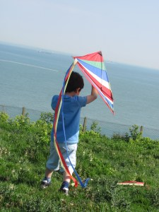 getting ready to fly a kite near the sea