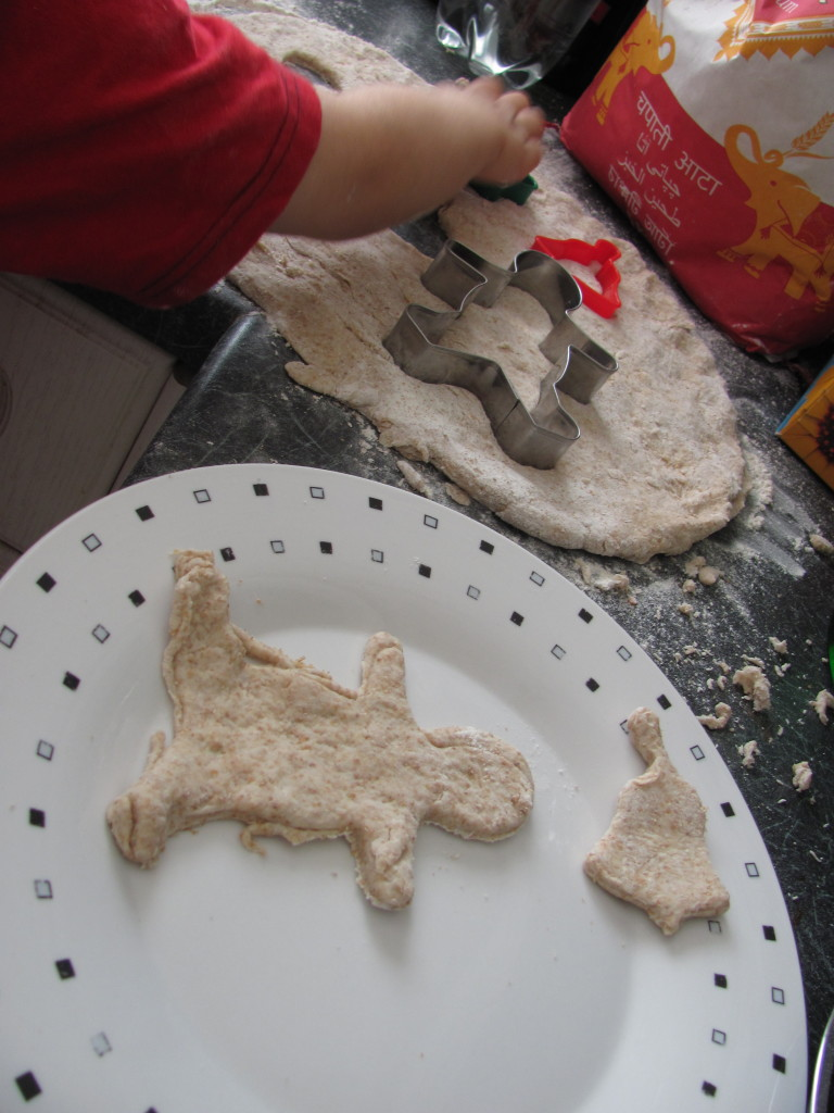 cutting out shapes from dough