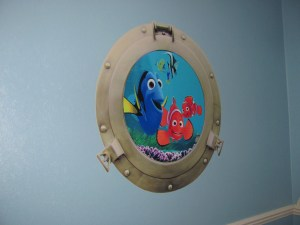 finding nemo wall sticker, finding nemo wall art, porthole shaped wall sticker, wall sticker with dory nemo and marlin, clownfish wall sticker, large fish wall sticker, disney finding nemo