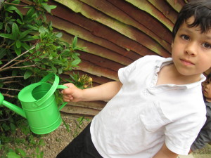 boy looking with green watering can