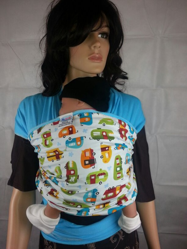 baby wrap fabric carrier for young baby in turquoise colour with cool funky design