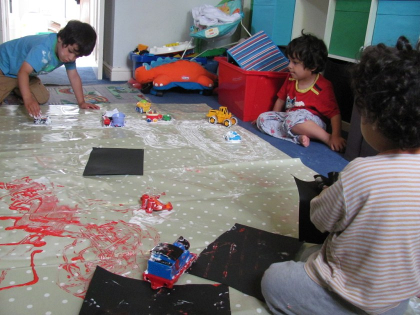 3 brothers playing in messy play