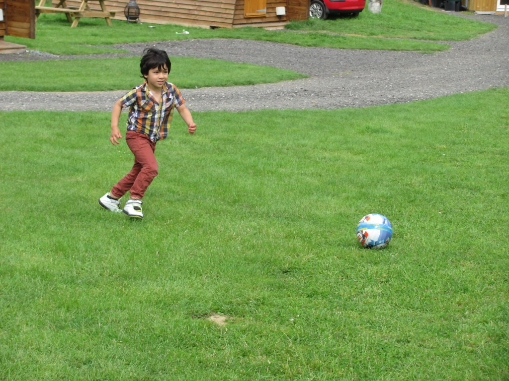 boy in the countryside playing football
