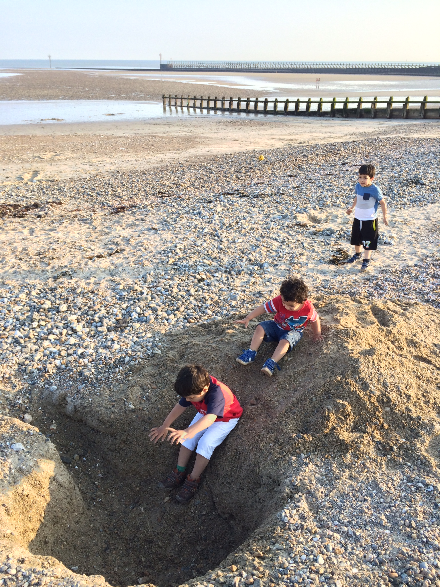 make a sand slide at the seaside