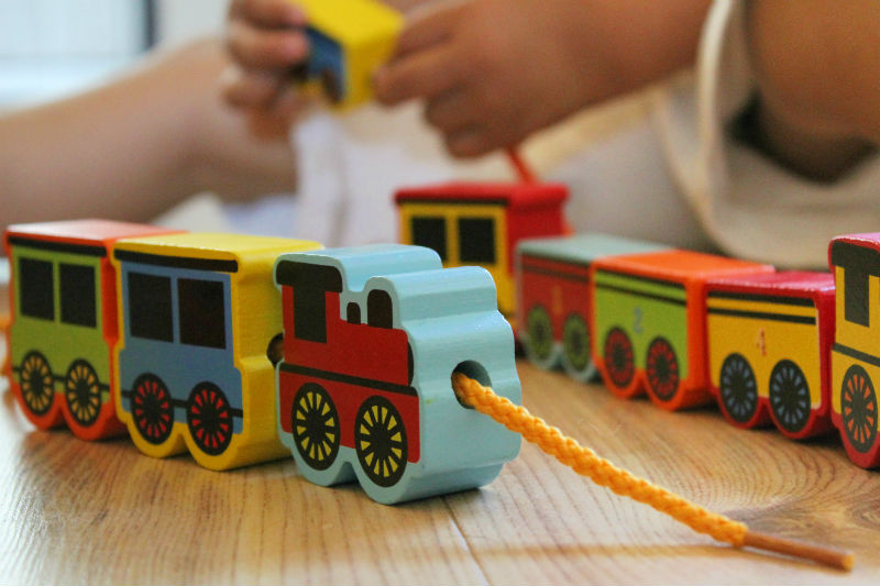 wooden threading beads trains