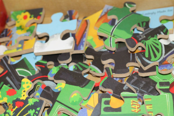 wooden puzzle pieces from bigjigs flying scotsman puzzle