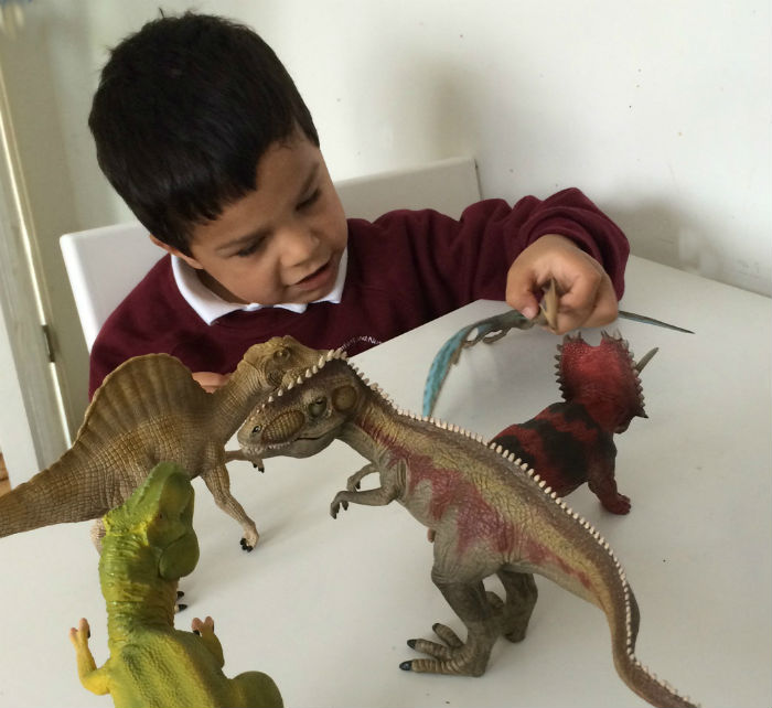 playing with Schleich toy dinosaurs
