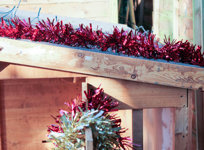 tinsel to decorate wooden playhouse for winter and christmas
