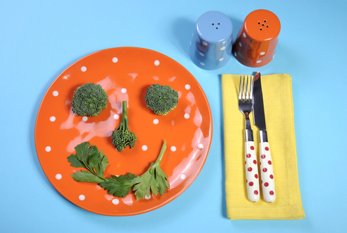 making smiley face out of vegetables