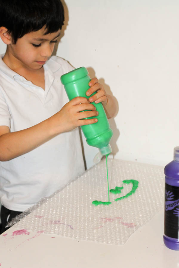squeezing paint onto bubble wrap ready fro bubble wrap painting
