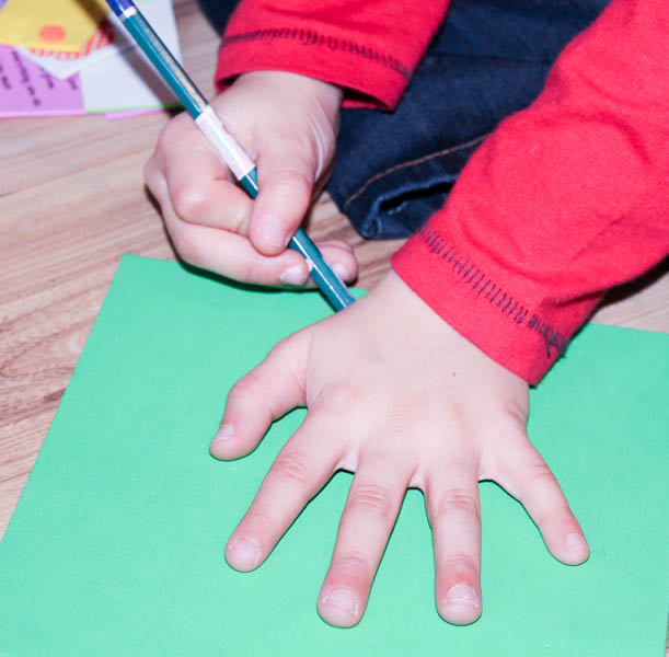 drawing around your hand for a handprint craft