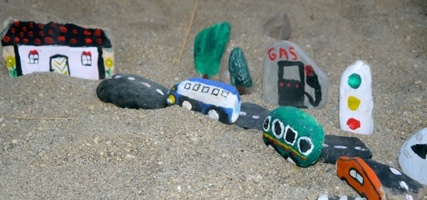 make an outdoor car track with stones
