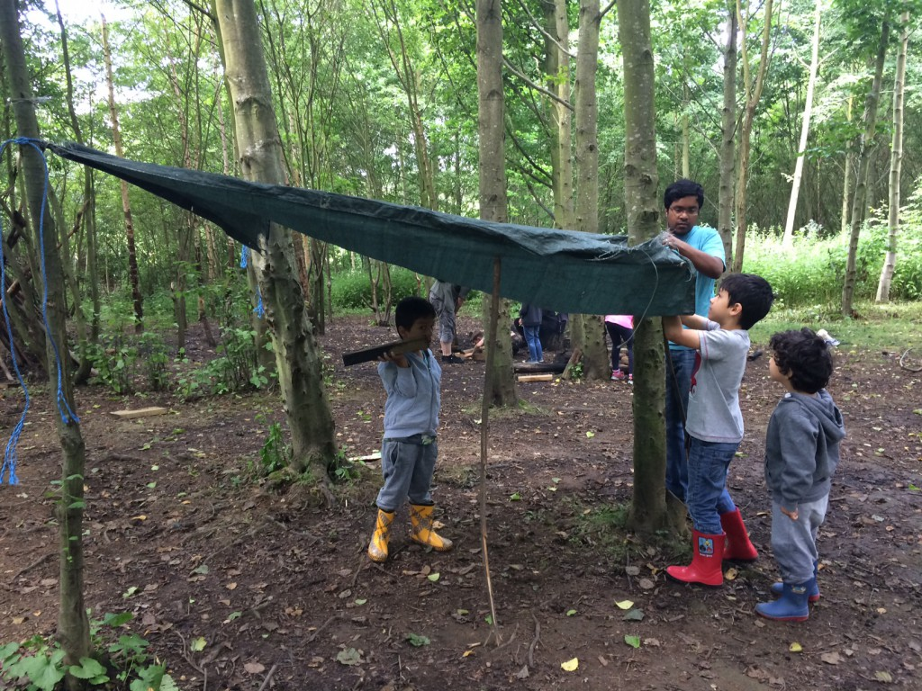 bushcraft survival building a shelter with kids