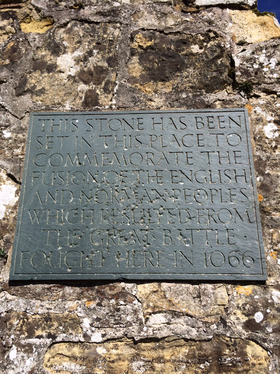 this stone has been set in this place to commemorate the fusion of the english and norman people which resulted from the great battle fought here in 1066