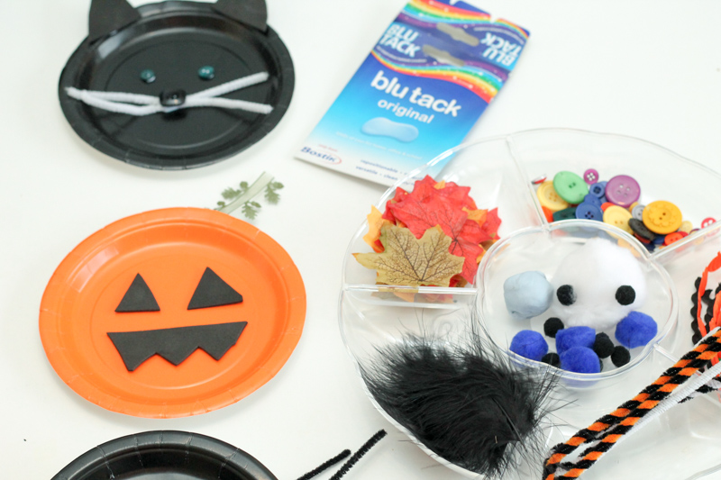 Invitation to create with paper plates, loose parts and blu tack