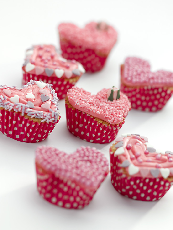 Cute pink heart shaped cupcakes for Valentines day, easy recipe for baking with kids and fun to decorate!