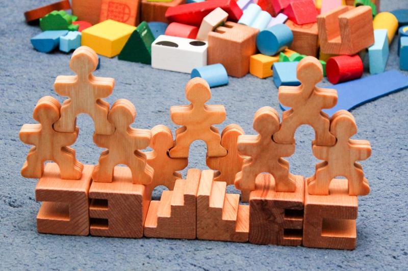 Exploring Symmetry with Wooden Building Blocks and flockmen