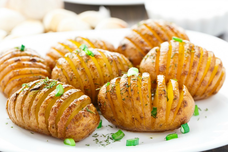 Accordion baked potatoes on a white plate
