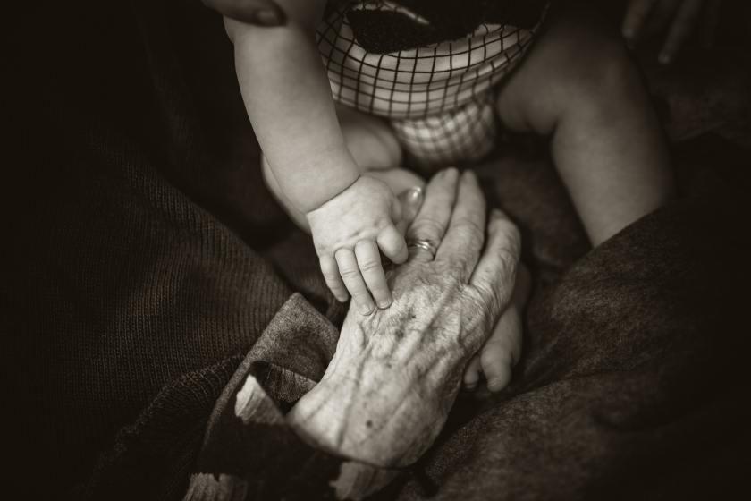 baby and elderly hand