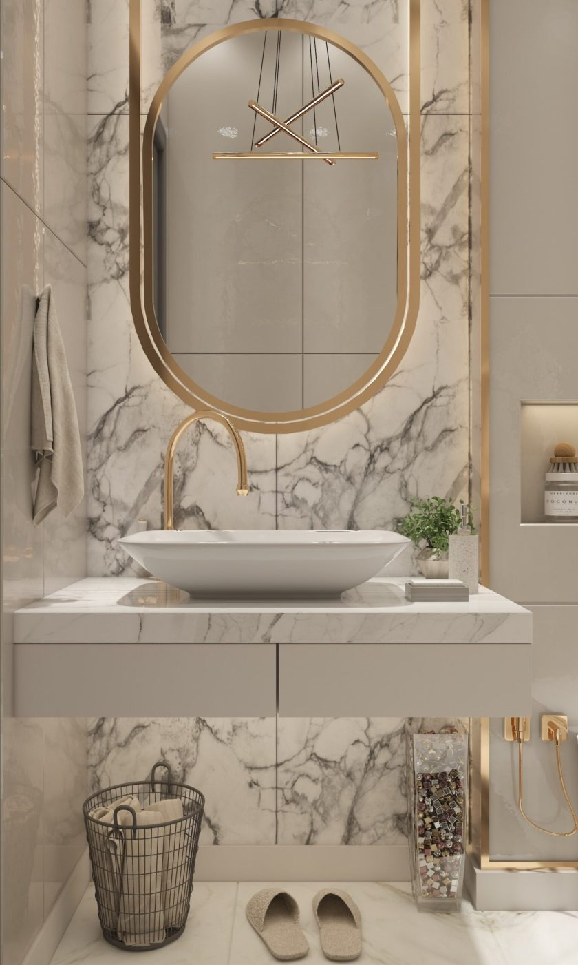 bathroom with large gold mirror