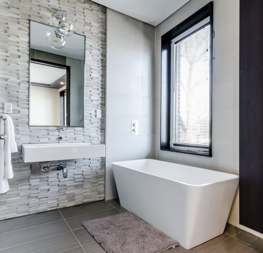 bathroom with natural light and large window