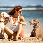JT Clough of Maui Dog Remedies with her pups, Emmy and Carmela