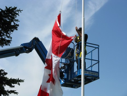 Hoisting the Canadian flag