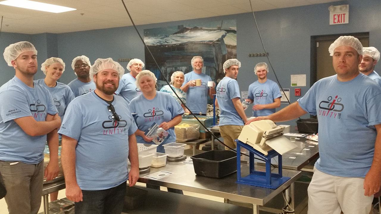 Convergint day colleagues packaging food