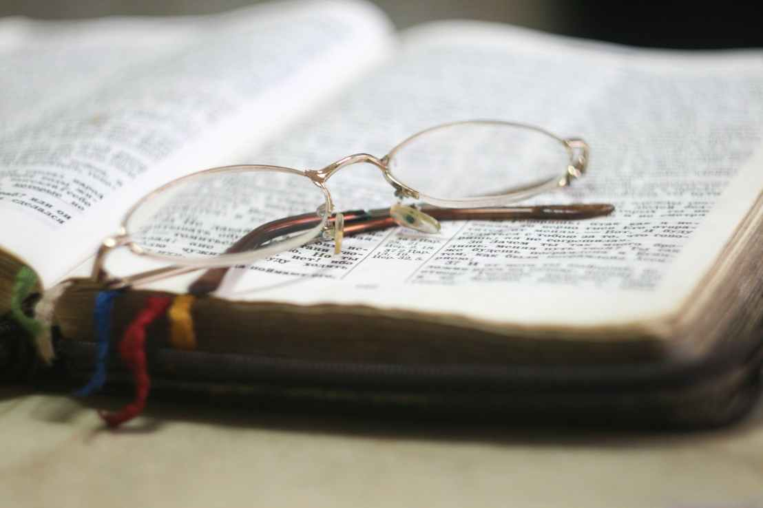 eyeglass with gold colored frames