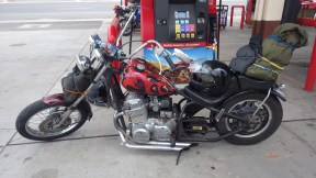 I'm not really into Choppers, but I do have a soft sport for custom-built hard tail chops with 4-cylinder Japanese engines. Watching my bro Wayne ride off to a rock festival on his Suzuki GS550 chop with his tent tied to the handlebars could have been my earliest influence to do this sort of trip.