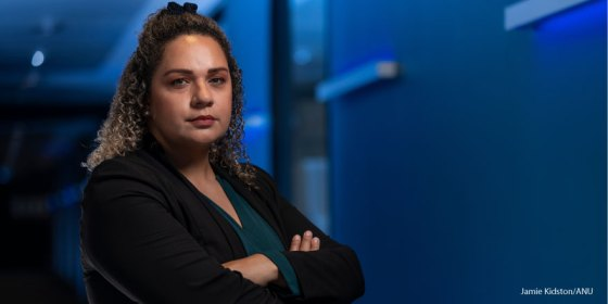 Associate Professor Lisa Whop stands with her arms folded and looks at the camera. Image credit Jamie Kidston, ANU
