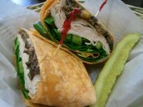 Suddenly Susan's | Arizona Wrap: Roasted turkey, pepper jack cheese, green pepper, onion, spinach, and our roasted garlic black bean salsa in a tomato wrap with dijon mustard.