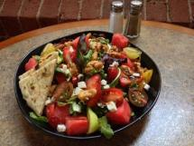 Waterworks Cafe   Watermelon Salad with mixed greens, arugula, strawberries, feta, heirloom tomatoes and candied walnuts