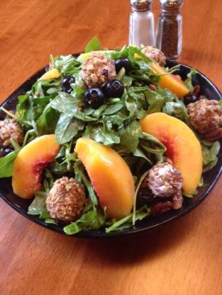 Waterworks | Honey Peach Arugula Salad w. fresh peaches, candied pecans, blueberries, honey vinaigrette and honey blueberry Chevre cheese