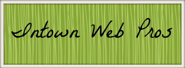 Our company name, Intown Web Pros, in black handwriting across a background that resembles green grass