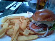 "Mmm pub burger with Swiss & perfectly cooked ""chips"""
