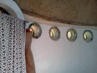 Persian rugs serve as door covers.