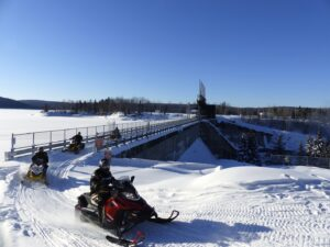 Riding the trail over dam at Lac Taureau