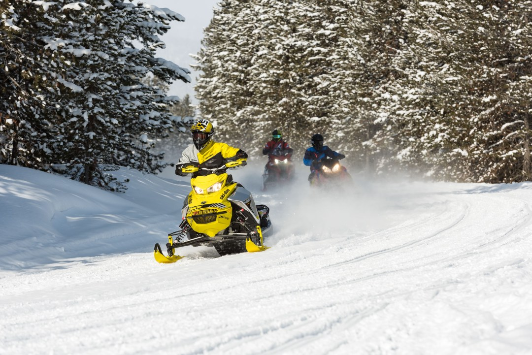 fine tuning new snowmobiles on the trail