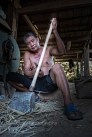 Kongge man making a bamboo handle for a hoe ... I think he slipped a few times (no fingers left hand)