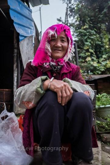At the Mengyang market, Ahka woman