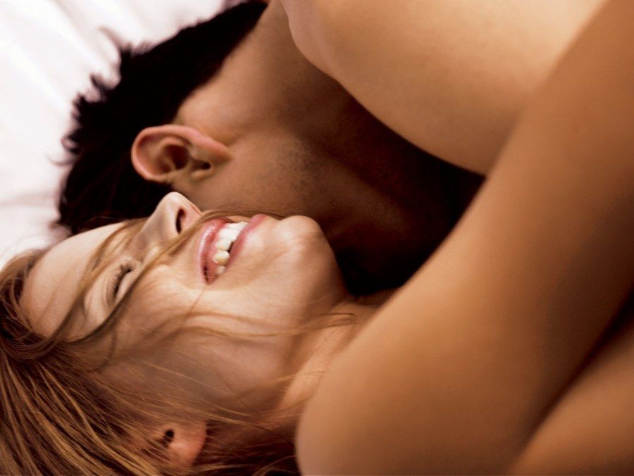 sex-love-life-2013-11-02-woman-laughing-in-bed-main