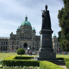 The BC parliament buildings, with a statue of Queen Victoria in the foreground