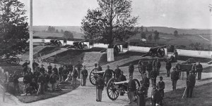 Image of Fort Stevens with soldiers and carts around