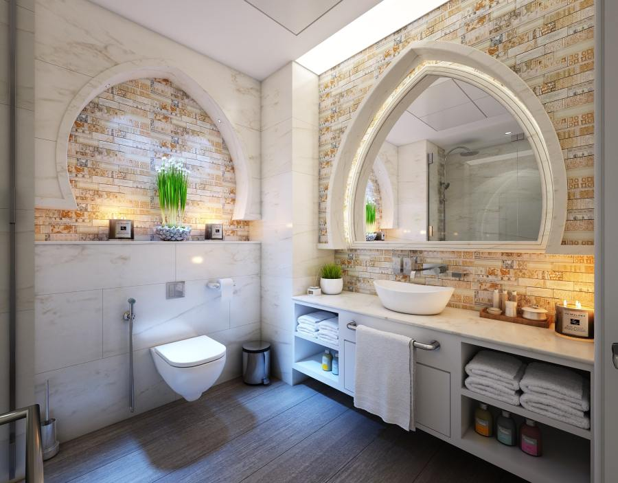 fancy brick and marble bathroom with white outer bowl sink and toliet