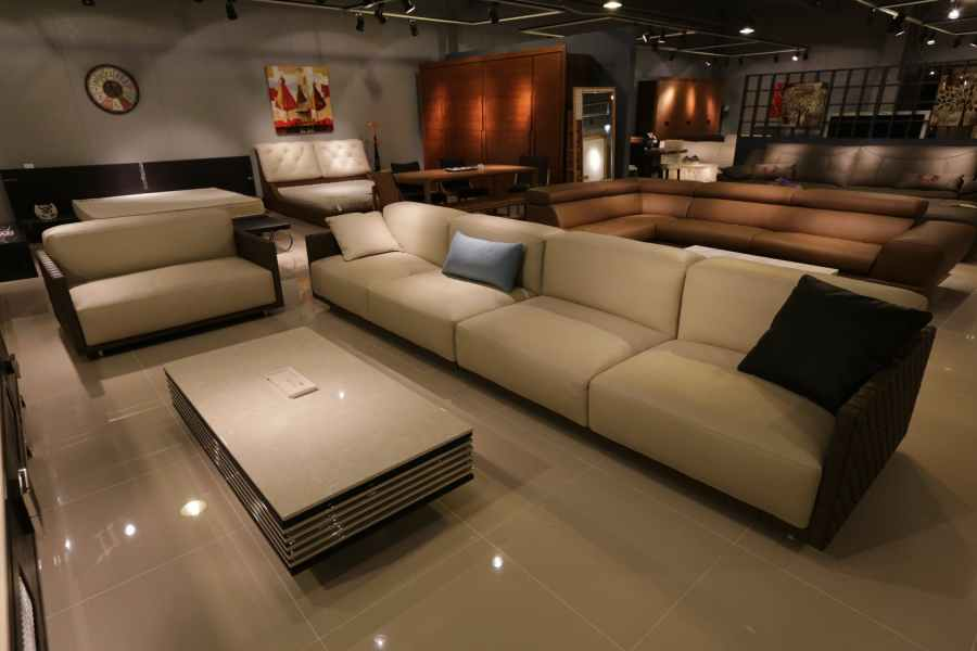 white couch in fancy theatre room with marble tile floor