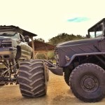 Military Truck and Monster Truck Clash Head to Head in Epic Video