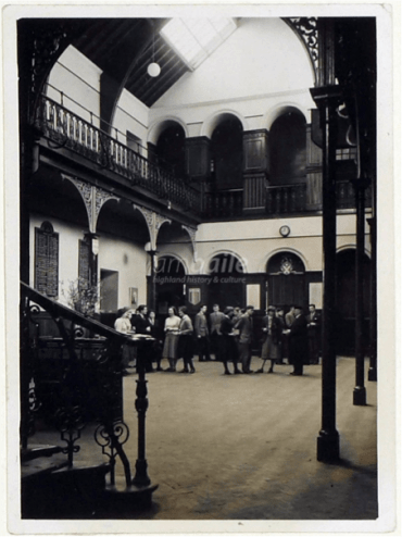1950's image of the main Assembly Hall viewed from the stair with balcony over, and World War II memorial plaques on the wall © Am Baile/ Highlife Highland.